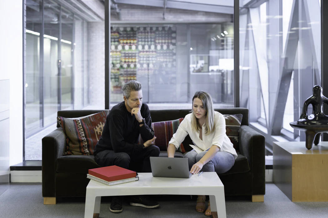 Sales meeting in an open-plan office by Campaign creators on Unsplash